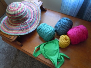 Fun summer color yarn with my sun hat and bathing suit, just so I could make sure it all goes together.